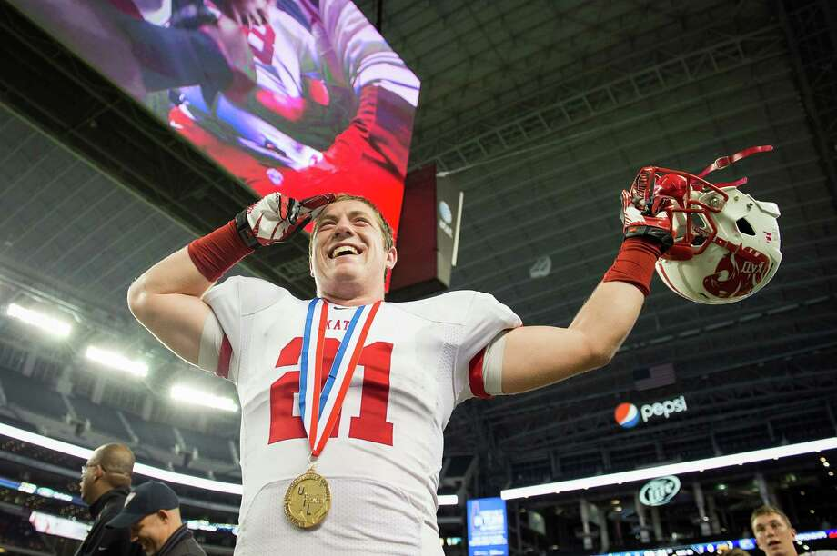 Katy defensive back Quinn Atwood salutes the crowd after the victory. Photo: Smiley N. Pool, Houston Chronicle / © 2012  Houston Chronicle