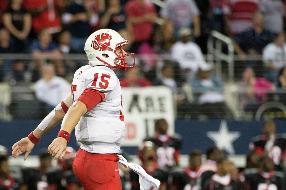 Katy quarterback Kiley Huddleston (15) celebrates a touchdown run by Adam Taylor during the second half. Photo: Smiley N. Pool, Houston Chronicle / © 2012  Houston Chronicle