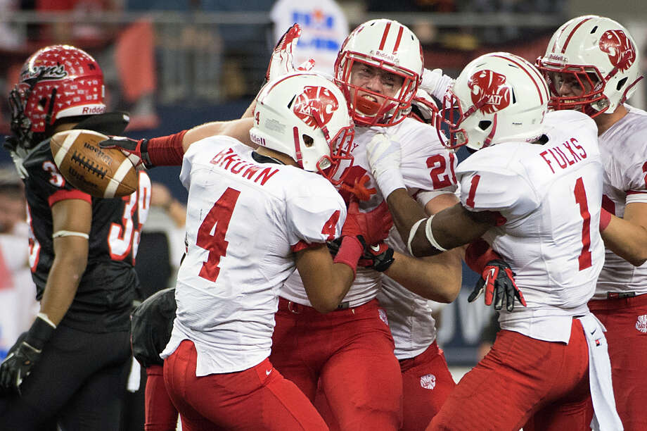 Katy defensive back Quinn Atwood (21) celebrates an interception to preserve the victory with Isaiah Brown (4) and  Kyle Fulks (1) during the fourth quarter. Photo: Smiley N. Pool, Houston Chronicle / © 2012  Houston Chronicle