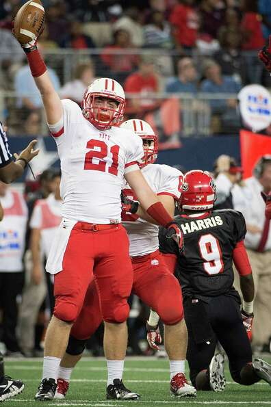 Katy defensive back Quinn Atwood (21) celebrates after intercepting a pass intended for Cedar Hill w