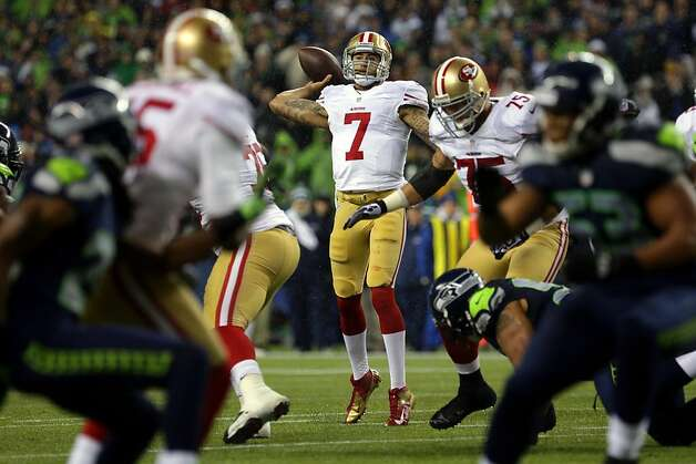 Colin Kaepernick, center, quarterback of the San Francisco 49ers, looks for a teammate to pass to during the first half of the Seahawks and 49ers game Sunday, Dec. 23, 2012, at CenturyLink Field in Seattle, WA. Photo: Jordan Stead, Special To The Chronicle