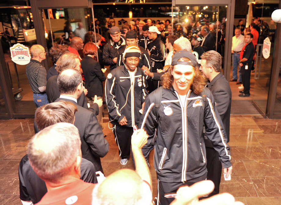 Oregon State football players are greeted as they arrive at the Hyatt Regency Sunday night to begin preparations for their Valero Alamo Bowl game versus the Texas Longhorns. Photo: Robin Jerstad, Express-News