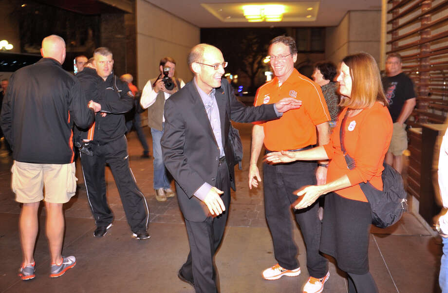 Oregon State head football coach Mike Riley greets well-wisher as he and the team arrive at the Hyatt Regency hotel Sunday night for their Valero Alamo Bowl game versus the Texas Longhorns. Photo: Robin Jerstad, Express-News