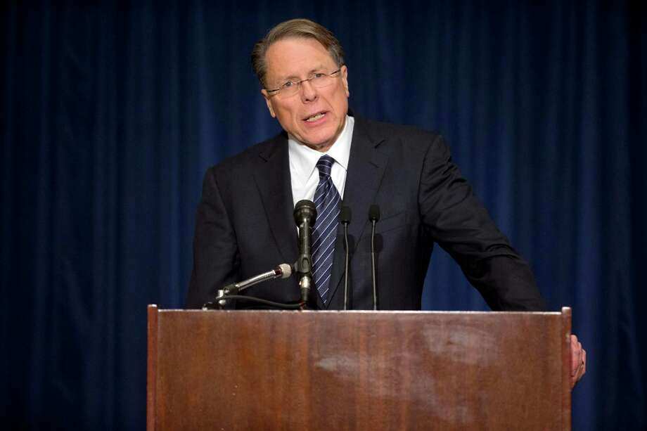 "The National Rifle Association executive vice president Wayne LaPierre, gestures during a news conference in response to the Connecticut school shooting on Friday, Dec. 21, 2012 in Washington.   The nation's largest gun-rights lobby is calling for armed police officers to be posted in every American school to stop the next killer ""waiting in the wings.""  (AP Photo/ Evan Vucci) Photo: Evan Vucci"