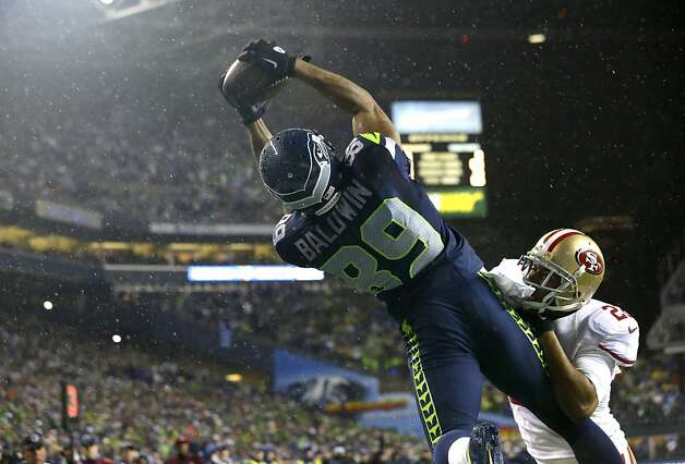 Doug Baldwin, who played for Jim Harbaugh at Stanford, beats Carlos Rogers for one of his two second-half touchdown catches. Photo: Elaine Thompson, Associated Press