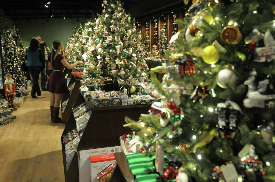 Shoppers search for Christmas ornaments at Wit's End Giftique on Sunday, Dec. 23, 2012 in Clifton Park, NY.  The store will be open on December 24th from 9am to 5pm.  The 28,000 square-foot store was started 39 years ago with just 8,000 square-feet and Susan Hoffman, owner and operator said that they just keep adding to it.  Hoffman said that they try to capture the European boutique shopping feel and they carry products from all over the U.S. and Europe.  Beginning in January Hoffan said that she will begin looking all over to find the distinctively different Christmas ornaments and decorations for next year.  (Paul Buckowski / Times Union) Photo: Paul Buckowski