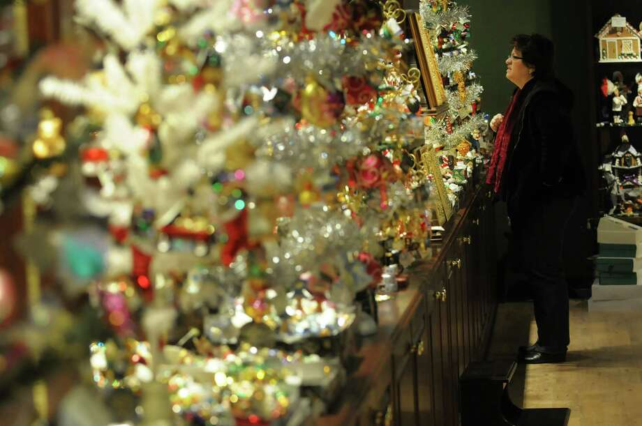 Sherry Terry from Wynantskill looks over ornaments at Wit's End Giftique on Sunday, Dec. 23, 2012 in Clifton Park, NY.  The store will be open on December 24th from 9am to 5pm.  The 28,000 square-foot store was started 39 years ago with just 8,000 square-feet and Susan Hoffman, owner and operator said that they just keep adding to it.  Hoffman said that they try to capture the European boutique shopping feel and they carry products from all over the U.S. and Europe.  Beginning in January Hoffan said that she will begin looking all over to find the distinctively different Christmas ornaments and decorations for next year.  (Paul Buckowski / Times Union) Photo: Paul Buckowski
