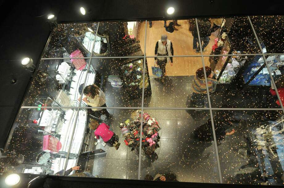 Shoppers and employees are reflected in the ceiling at Wit's End Giftique on Sunday, Dec. 23, 2012 in Clifton Park, NY.  The store will be open on December 24th from 9am to 5pm.  The 28,000 square-foot store was started 39 years ago with just 8,000 square-feet and Susan Hoffman, owner and operator said that they just keep adding to it.  Hoffman said that they try to capture the European boutique shopping feel and they carry products from all over the U.S. and Europe.  Beginning in January Hoffan said that she will begin looking all over to find the distinctively different Christmas ornaments and decorations for next year.  (Paul Buckowski / Times Union) Photo: Paul Buckowski