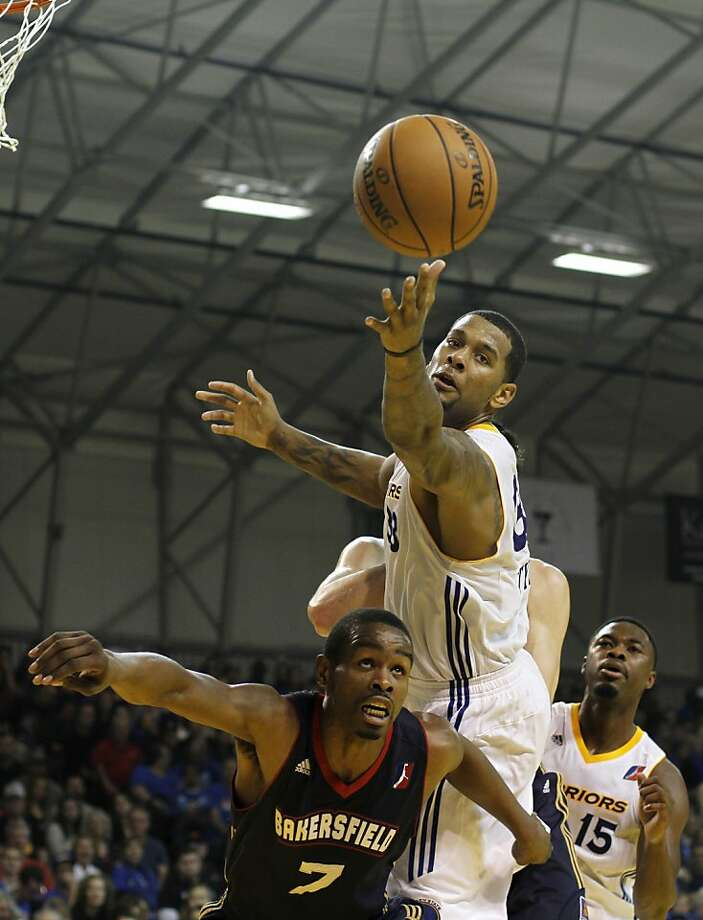Jeremy Tyler reaches for a ball over a Jam defender in the third quarter. The Santa Cruz Warriors held their first game Sunday, December 23, 2012 against the Bakersfield Jam. The Warriors defeated the Jam 93 to 88. Photo: Sean Culligan, Special To The Chronicle