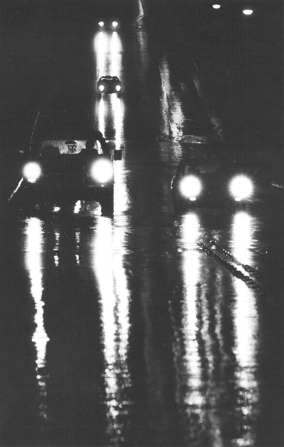 Rain falls on traffic on Hillcrest Friday night, Jan. 11, 1985. The rain turned to snow overnight, and in two days, San Antonio received a record 13.5 inches of snow. Photo: San Antonio Express-News File Photo