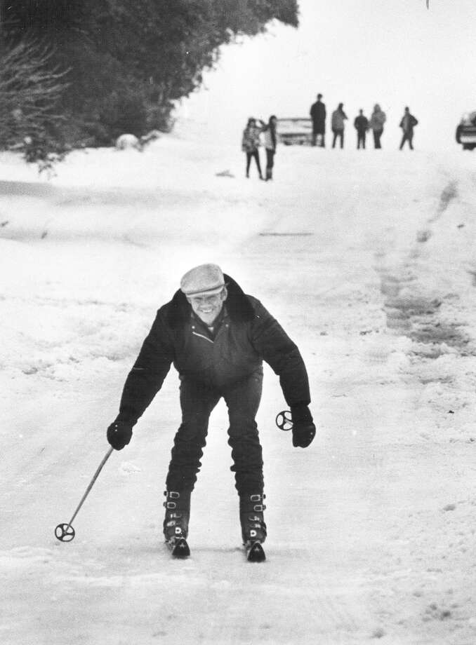 """Kind of like the bunny slope of a ski area,"" remarks Andy Jabsen as he skies down a hill on Hillcrest Road on Jan. 13, 1985. Photo: San Antonio Express-News File Photo"