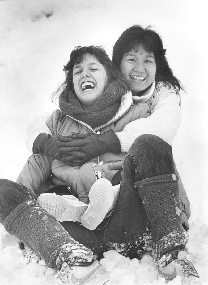 Two women sled down a hill at Hildebrand and Devine, behind Trinity University, on Jan. 13, 1985. Photo: San Antonio Express-News File Photo