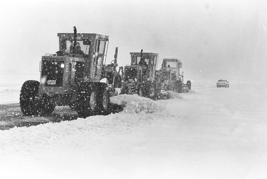 Plows clear the north-south runway at the San Antonio International Airport as more snow falls in January 1985. Photo: San Antonio Express-News File Photo