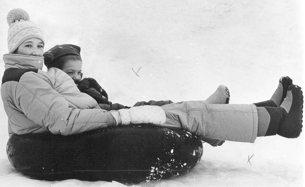 Meagan MacDonald and Elizabeth Wood slide down an embankment on an intertube at Stadium Drive and Hildebrand on Jan. 13, 1985.