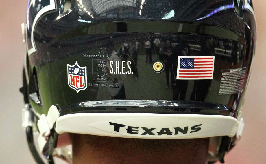 "Houston Texans tackle Ryan Harris wears ""S.H.E.S"" in honor of Sandy Hook Elementary School on his helmet, along with all of the Texans players. Photo: Karen Warren, Houston Chronicle / © 2012 Houston Chronicle"