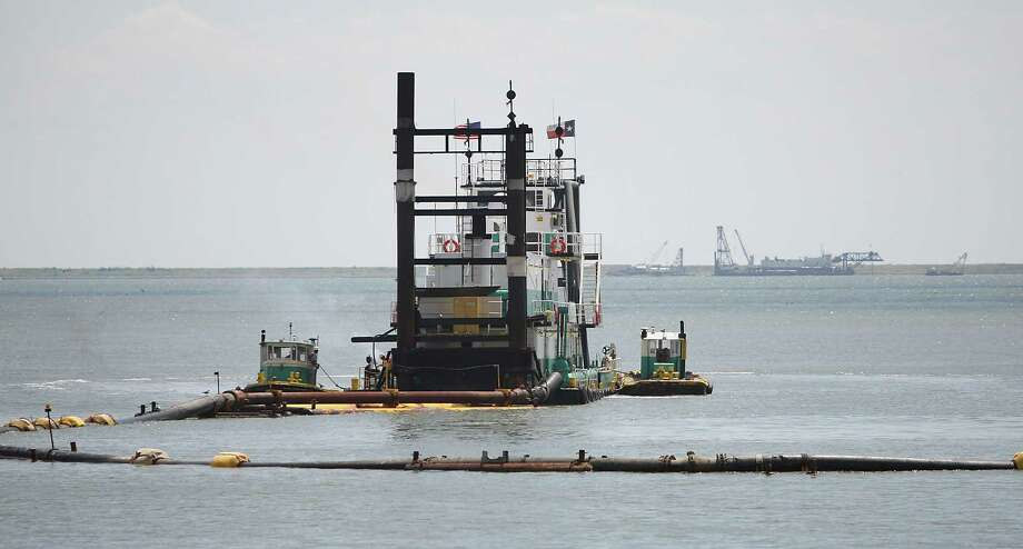Dredges do maintenance work at the Bayport Container Terminal. Photo: Karen Warren, Staff / © 2012  Houston Chronicle