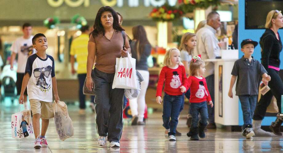 Daniel Hernandez, 8, left, and his mother Elisa Ramirez walk through the Baybrook Mall as the shop for Christmas, Monday, Nov. 19, 2012,  in Friendswood. Ramirez says she only going to shop on Monday and tuesday so she can spend time with family the rest of the week.  ( Nick de la Torre / Houston Chronicle ) Photo: Nick De La Torre, Staff / © 2012  Houston Chronicle