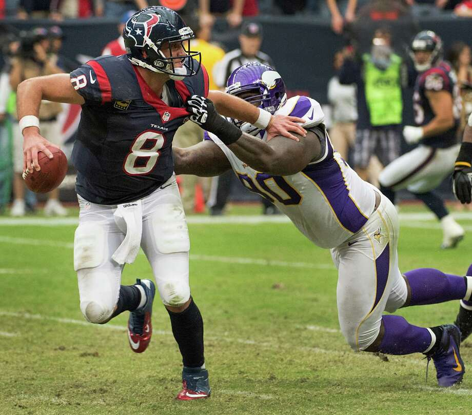 Texans quarterback Matt Schaub fails to elude Vikings defensive tackle Fred Evans. The 14-yard loss came on third down after the Texans had the ball 1 yard from the end zone, just one in a list of third-down misfires. Photo: Smiley N. Pool, Staff / © 2012  Houston Chronicle