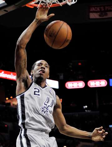 The Spurs' Kawhi Leonard dunks during the first half against the Mavericks, Sunday, Dec. 23, 2012, in San Antonio. Photo: Darren Abate, Associated Press / FR115 AP