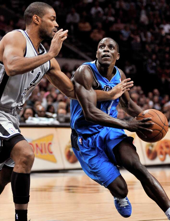 The Mavericks' Darren Collison (right) is fouled by the Spurs' Gary Neal during the second half, Sunday, Dec. 23, 2012, in San Antonio. San Antonio won 129-91. Photo: Darren Abate, Associated Press / FR115 AP