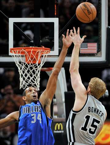 San Antonio Spurs' Matt Bonner (15) shoots over Dallas Mavericks' Brandan Wright during the second half of an NBA basketball game, Sunday, Dec. 23, 2012, in San Antonio. San Antonio won 129-91. Photo: Darren Abate, Associated Press / FR115 AP