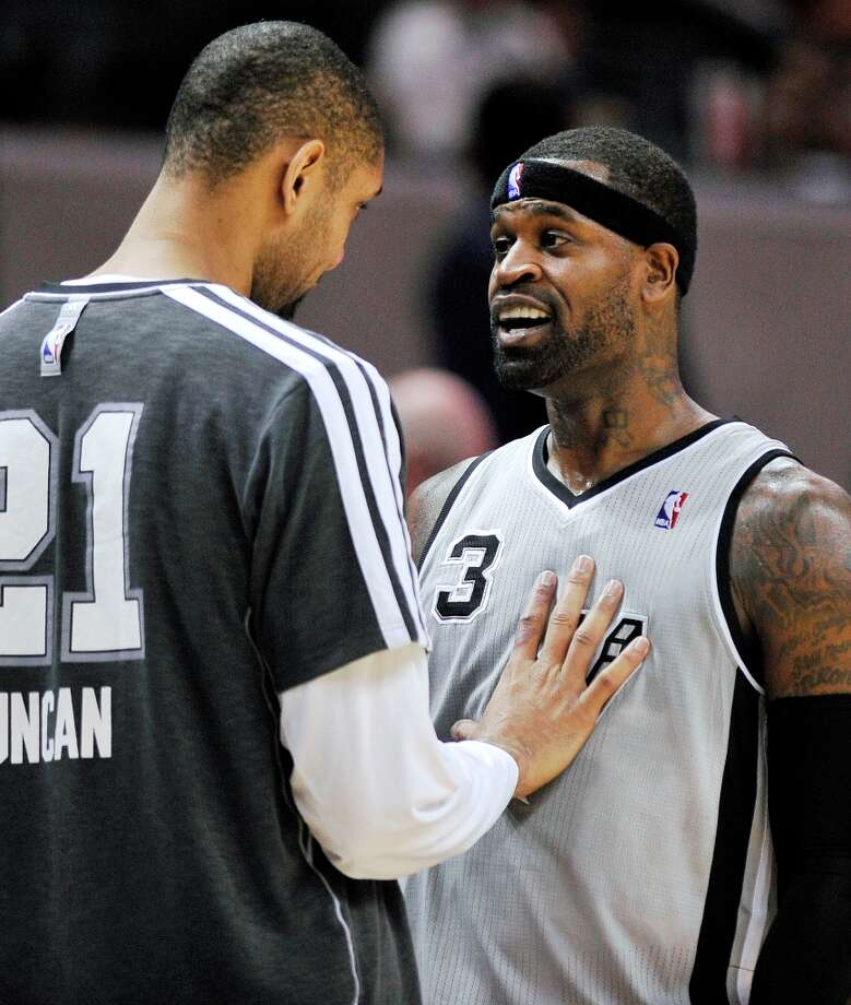 The Spurs' Stephen Jackson (right) talks with teammate Tim Duncan during the second half against the Mavericks, Sunday, Dec. 23, 2012, in San Antonio. San Antonio won 129-91. Photo: Darren Abate, Associated Press / FR115 AP