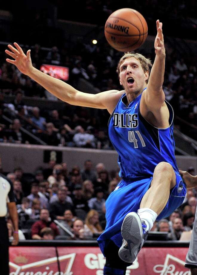 The Mavericks' Dirk Nowitzki chases a loose ball during the first half against the Spurs, Sunday, Dec. 23, 2012, in San Antonio. Photo: Darren Abate, Associated Press / FR115 AP