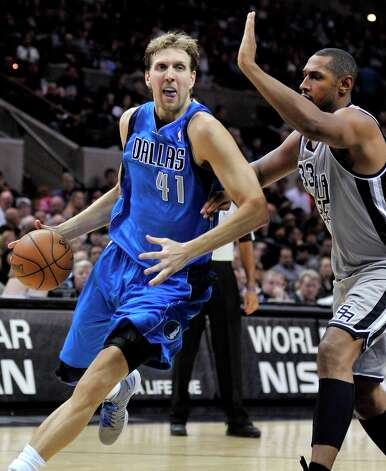 The Mavericks' Dirk Nowitzki (left) drives around the Spurs' Boris Diaw during the second half, Sunday, Dec. 23, 2012, in San Antonio. San Antonio won 129-91. Photo: Darren Abate, Associated Press / FR115 AP