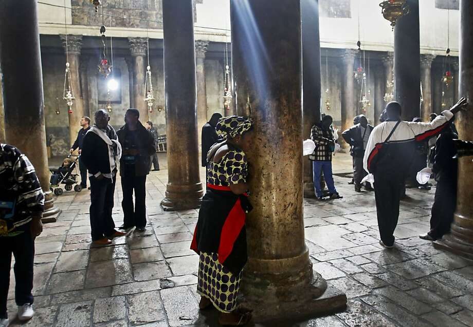A Christian worshiper prays at the Church of Nativity, traditionally believed by Christians to be the birthplace of Jesus Christ, ahead of Christmas, in the West Bank town of Bethlehem, Sunday, Dec. 23, 2012. (AP Photo/Nasser Shiyoukhi) Photo: Nasser Shiyoukhi, Associated Press