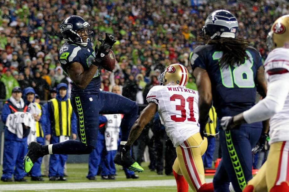 Anthony McCoy, left, of the Seattle Seahawks, makes a touchdown catch during the first half of the Seahawks and 49ers game Sunday, Dec. 23, 2012, at CenturyLink Field in Seattle, WA. The Seahawks led 28-6 at the half.  (Jordan Stead / Special to the Chronicle)