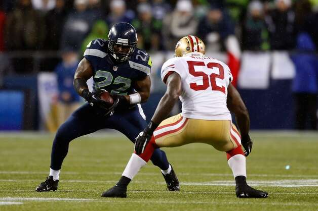 Robert Turbin #22 of the Seattle Seahawks runs for yards after the catch against Patrick Willis #52 of the San Francisco 49ers at Qwest Field on December 23, 2012 in Seattle, Washington.  (Otto Greule Jr / Getty Images)