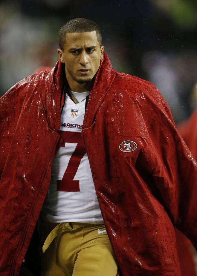 San Francisco 49ers quarterback Colin Kaepernick stands on the sideline in the first half of an NFL football game against the Seattle Seahawks, Sunday, Dec. 23, 2012, in Seattle.  (John Froschauer / Associated Press)