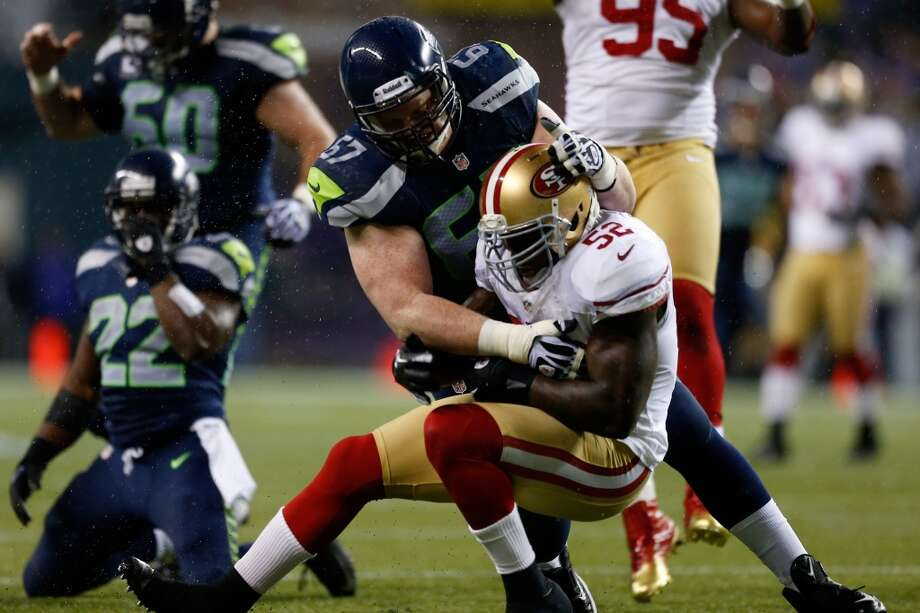 Patrick Willis #52 of the San Francisco 49ers intercepts a pass in the first half against Paul McQuistan #67 of the Seattle Seahawks at Qwest Field on December 23, 2012 in Seattle, Washington.  (Otto Greule Jr / Getty Images)