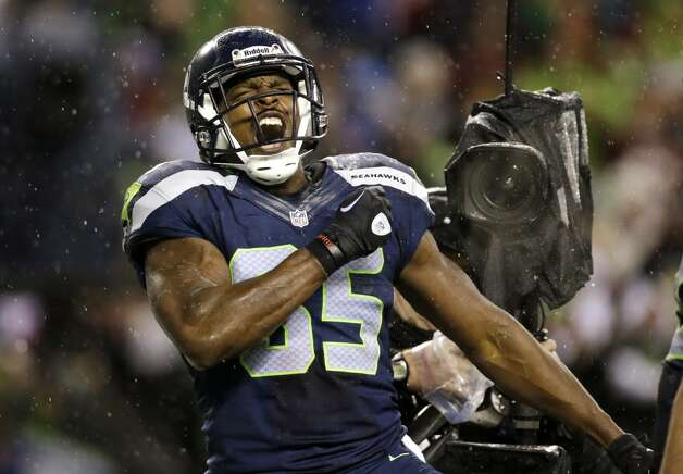 Seattle Seahawks' Anthony McCoy reacts after scoring against the San Francisco 49ers late in the first half of an NFL football game, Sunday, Dec. 23, 2012, in Seattle.  (Elaine Thompson / Associated Press)