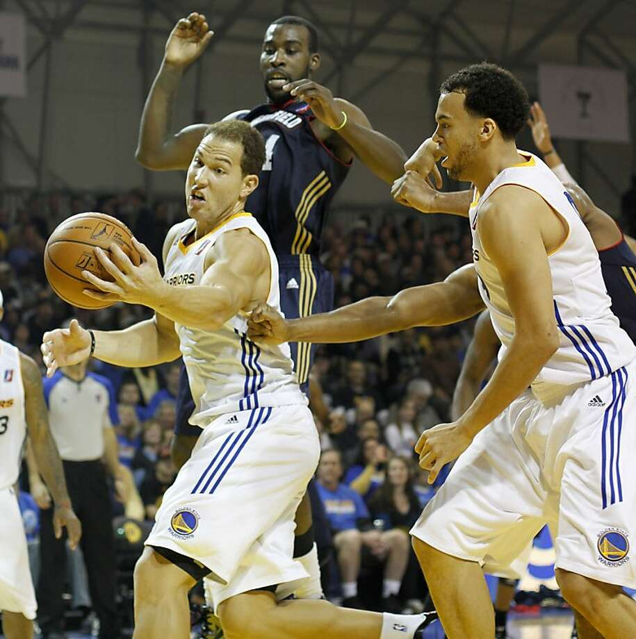Taylor Griffin reaches for the ball. The Santa Cruz Warriors held their first game Sunday, December 23, 2012 against the Bakersfield Jam. The Warriors defeated the Jam 93 to 88. Photo: Sean Culligan, Special To The Chronicle