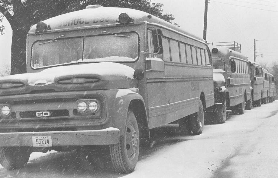 School buses sit covered with snow in Comfort after a snow storm hit the San Antonio area on Feb. 22, 1966. Photo: San Antonio Express-News File Photo