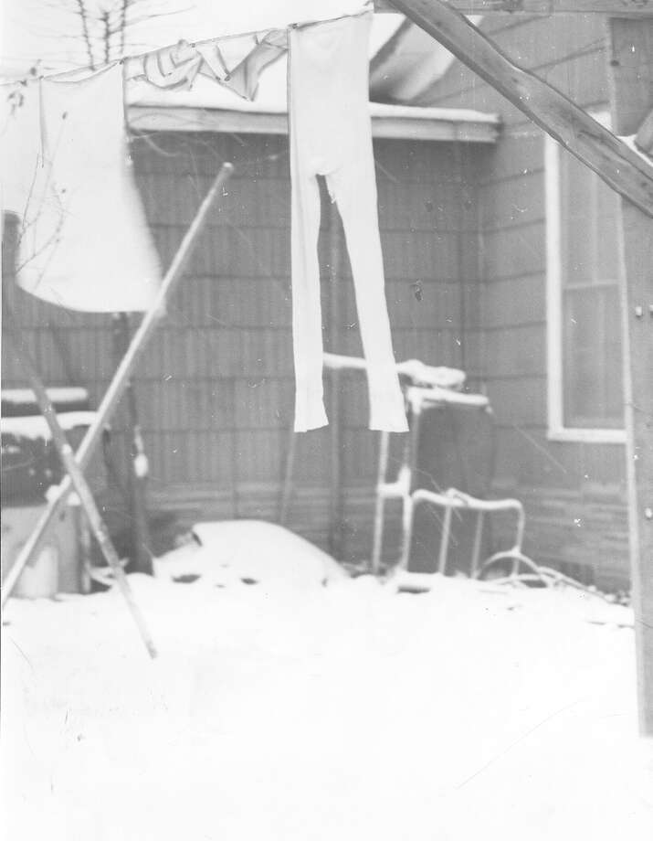 A pair of frozen long johns hang on a clothesline at a San Antonio home after a snow storm hit the city on Feb. 22, 1966. Photo: San Antonio Express-News File Photo
