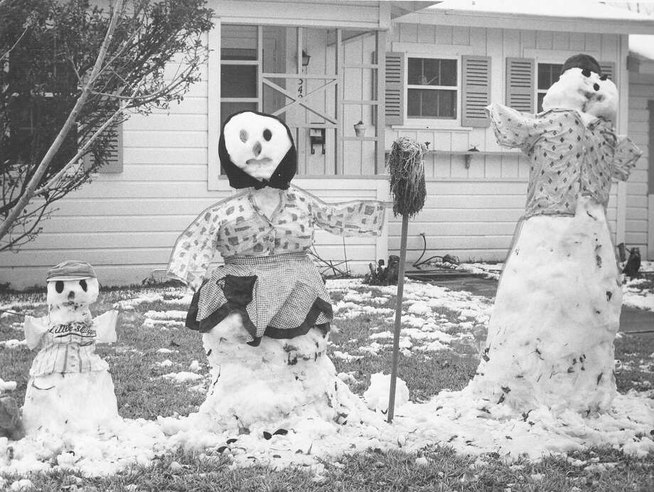Pappa, Momma and Baby snowpeople sit in the front yard of the home of Mr. and Mrs. Bernard H. Wendell in the 2300 block of Texas Avenue on Feb. 22, 1966. Mrs. Wendell built them with the help of neighbors. Photo: San Antonio Express-News File Photo