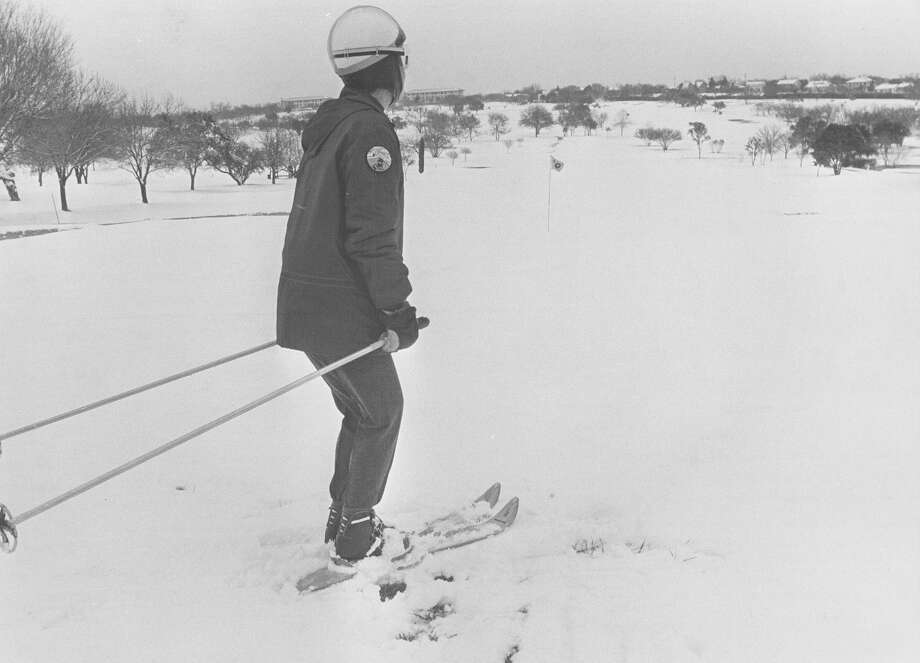 Mary Moore pauses to look at the snowy landscape while skiing after a snow storm hit San Antonio on Feb. 22, 1966. Photo: San Antonio Express-News File Photo