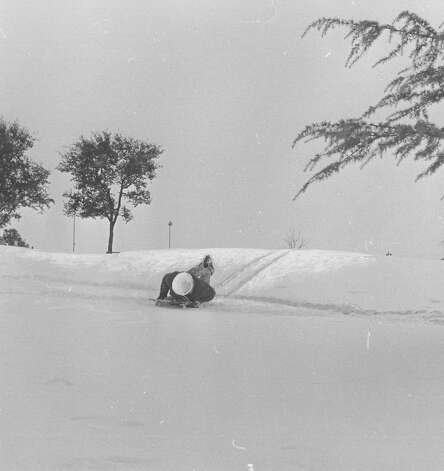 A child goes sledding after a snow storm in San Antonio on Feb. 22, 1966. Photo: San Antonio Express-News File Photo