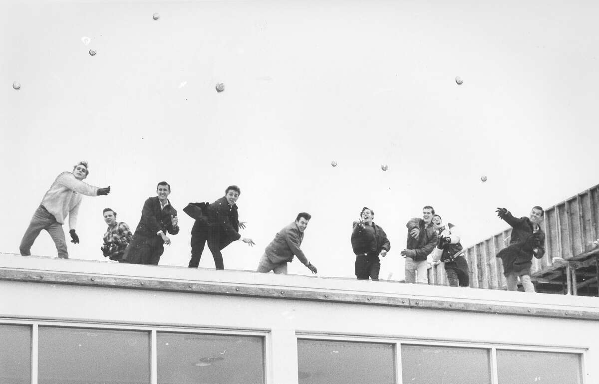 Young men throw snowballs from the roof of a San Antonio building on Feb. 22, 1966.