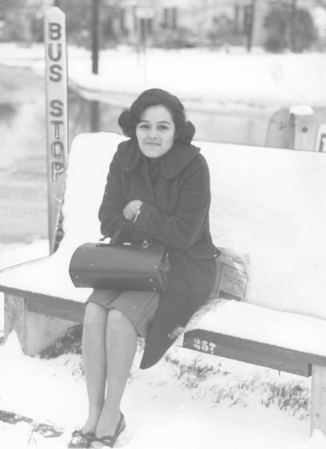 A woman waits at a bus stop in San Antonio after a snow storm on Feb. 22, 1966. Photo: San Antonio Express-News File Photo