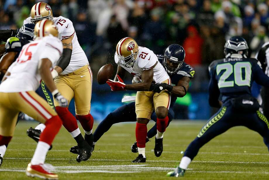 Frank Gore fumbles in wet conditions during a December 2012 loss in Seattle. San Francisco has seven turnovers combined in its past two games there. Photo: Otto Greule Jr, Getty Images