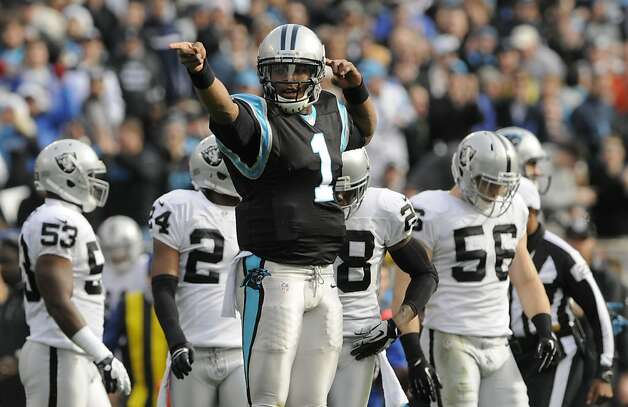 Carolina Panthers' Cam Newton (1) reacts after running for a first down against the Oakland Raiders during the first half of an NFL football game in Charlotte, N.C., Sunday, Dec. 23, 2012. (AP Photo/Mike McCarn) Photo: Mike McCarn, Associated Press
