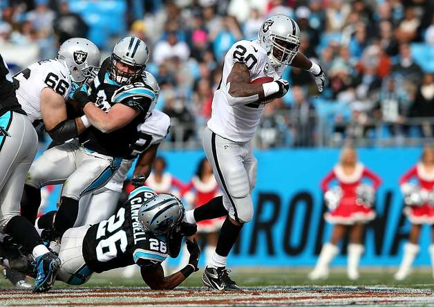 CHARLOTTE, NC - DECEMBER 23:   D.J. Campbell #26 of the Carolina Panthers tries to tackle Darren McFadden #20 of the Oakland Raiders during their game at Bank of America Stadium on December 23, 2012 in Charlotte, North Carolina.  (Photo by Streeter Lecka/Getty Images) Photo: Streeter Lecka, Getty Images
