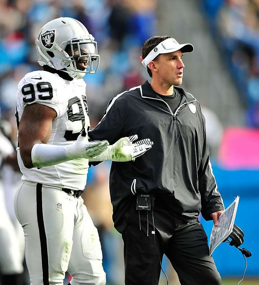 CHARLOTTE, NC - DECEMBER 23: Lamarr Houston #99 and coach Dennis Allen of the Oakland Raiders react to a Raider penalty against the Carolina Panthers at Bank of America Stadium on December 23, 2012 in Charlotte, North Carolina. (Photo by Grant Halverson/Getty Images) Photo: Grant Halverson, Getty Images