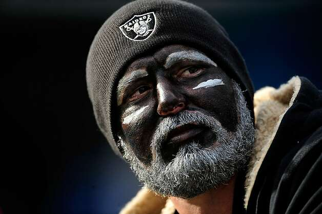 CHARLOTTE, NC - DECEMBER 23: A member of Raider Nation watches the game between the Carolina Panthers and the Oakland Raiders during play at Bank of America Stadium on December 23, 2012 in Charlotte, North Carolina. (Photo by Grant Halverson/Getty Images) Photo: Grant Halverson, Getty Images