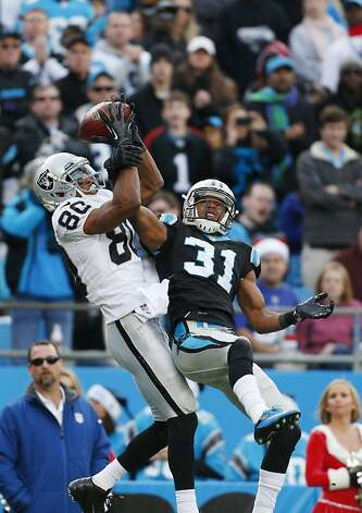 Carolina Panthers' James Dockery (31) defends a pass to Oakland Raiders' Rod Streater (80) during the second half of an NFL football game in Charlotte, N.C., Sunday, Dec. 23, 2012. The pass was incomplete. (AP Photo/Bob Leverone) Photo: Bob Leverone, Associated Press