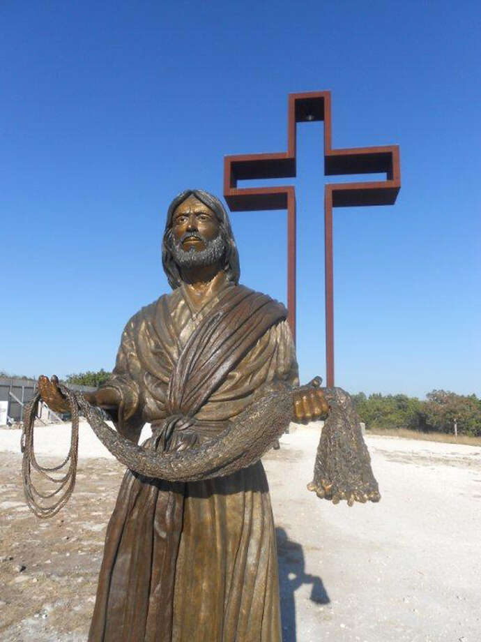 "A sculpture at the unfinished Coming King Sculpture Prayer Garden in Kerrville. Max Greiner designed ""The Empty Cross"" (background) and many of the other sculptures there. Photo: Max Greiner, Courtesy Photo"
