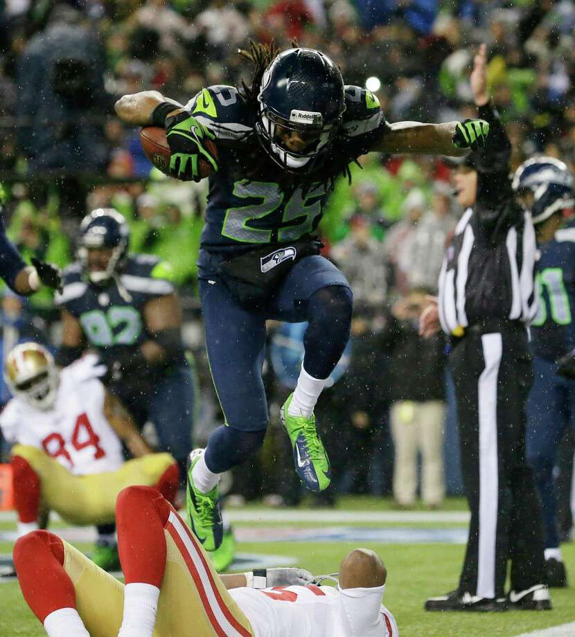 Seattle Seahawks' Richard Sherman jumps over San Francisco 49ers' Michael Crabtree as Sherman celebrates his interception in the second half of an NFL football game, Sunday, Dec. 23, 2012, in Seattle. Photo: AP